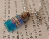 Alice in Wonderland MAGIC bubble drink me' necklace - Glass vial with blue liquid and MAGIC pink pearl