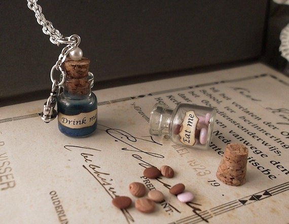 Alice in Wonderland - eat me - glass vial necklace - silver plated