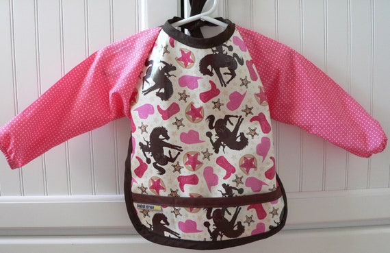 Laminated cotton long sleeved baby bib Cowgirl, brown and pink, Riley Blake