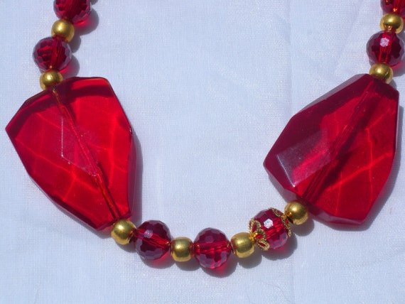Large Ruby Colored Crystal and Gold Necklace and earrings