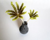 Eco friendly drop geometric vase made with recycled glass bottle and crocheted dark grey  tweed wool.