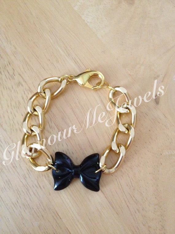 The TIFFANY Bracelet: Gold Chain Bracelet Linked With A Black Bow Resin Charm