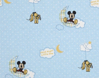 Mickey Mouse flannel fabric - Goodnight Little One - Mickey and Pluto in blue sky moon stars clouds by the continuous YARD