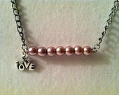 """Pearl Beaded Inspirational silver chain Necklace in a pink color with pewter """"Love"""" charm attached"""