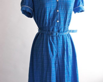 Vintage polyester short sleeve dress in bright blue with pink, green, white and black check with western shoulder detail and belt  size 16