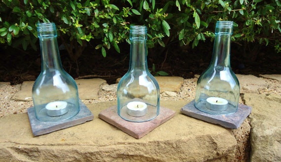 Recycled wine bottle tea light candle holders by for How to make candle holders out of wine bottles