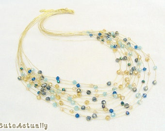 Blue gold crystal necklace, multi strands on silk thread