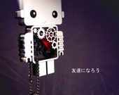 Small Kawaii Robot necklace with exposed mechanisms. Custom cut and customisable