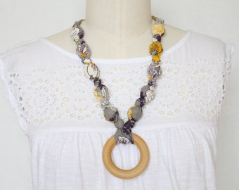 Fabric Necklace with Wood Ring Pendant,Teething Necklace, Chomping Necklace, Nursing Necklace - Purple and Gold flowers