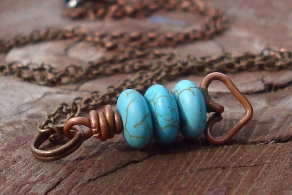 Blue Moon necklace. turquoise stones and copper shaped heart hangs from a delicate brass cable chain.