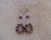 Purple loop dangles. Hangs about 2 inches.