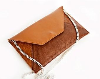 Embossed leather envelope clutch bag
