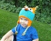 blue and orange crochet owl hat