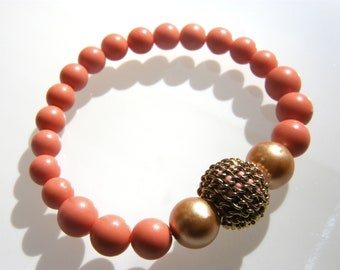 Coral and gold beaded stretch bracelet