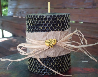 Two toned yellow and black hand rolled beeswax pillar candle