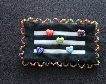 Black and white and hearts all over beaded pin brooch