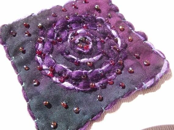 purple spiral pin brooch