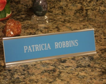 "Custom engraved 2"" x 8"" desk sign blue/white letters - with silver aluminum holder"