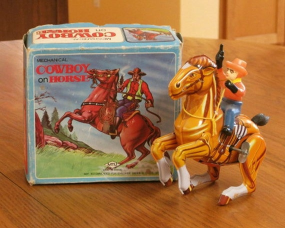 Tin Wind Up Mechanical Toy Western Cowboy on Horse