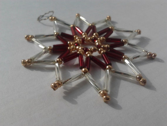 Christmas ornament, star made from seed beads in red, silver and gold