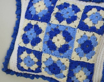 vintage crocheted blue granny square pillow