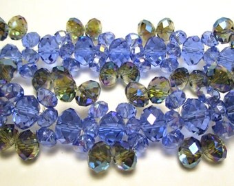Crystal bracelet 6mm and 3mm blue crystals with gray blue 5mm crystals with an AB finish on a stretchy cord