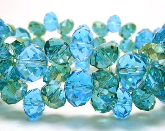 Crysal bracelet, 6mm and 5mm aqua blue crystals with 5mm aqua green crystals with an AB finish on a stretchy cord