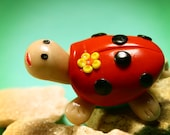 Handmade Red Ladybug turtle with yellow flowers on its shell (ornament sculpture)