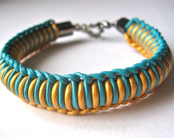 woven leather bracelet in turquoise and gold with gunmetal hardware