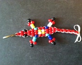 """With Powers Like Superman -Small Red """"Lucky Lizard"""" with White, Yellow, Aqua, & Blue Dots. Handmade to Save Lives - X Marks The Spot Design"""