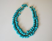 Statement vintage necklace with vivid blue beads from the 1970s
