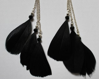 Black feather earrings with white metal. Handmade.