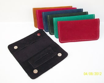 Handmade leather tobacco pouch avaliable in seven colors.