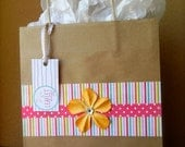 Colorfully decorated standard-sized gift bag
