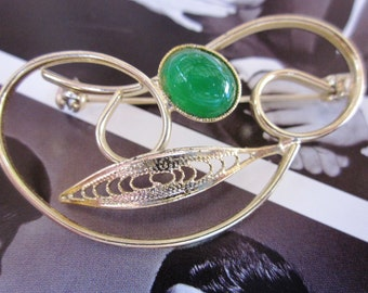 Vintage Brooch of Swirls, Filigree and a Faux Green Aventurine Stone