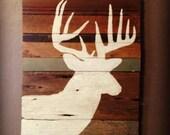 Deer Silhouette Painting on Rustic Wood
