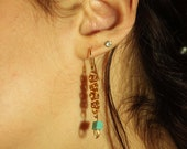Gold chain earrings with turquoise bead