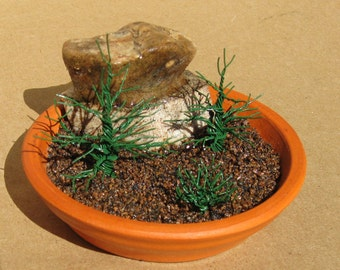 Nature in miniature in a terra-cotta plate - a mixed media wire tree sculpture.