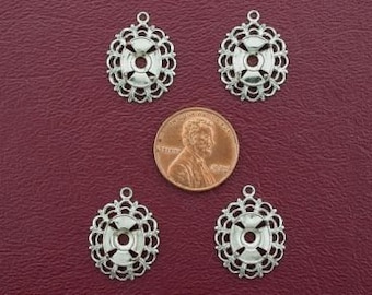 four silver plated 10x8  filigree cabochon mounting
