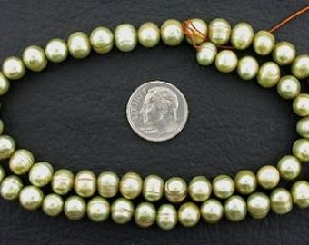 16 inch strand large light green freshwater pearls