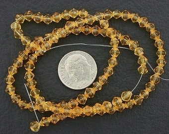 4mm gold-color  bicone glass bead strand