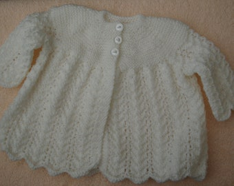 Traditional white baby jacket