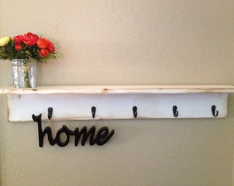 Antiqued white shelf with 5 hooks and a built in mason jar