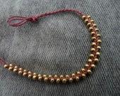 cute handmade bead bracelet: gold - purple