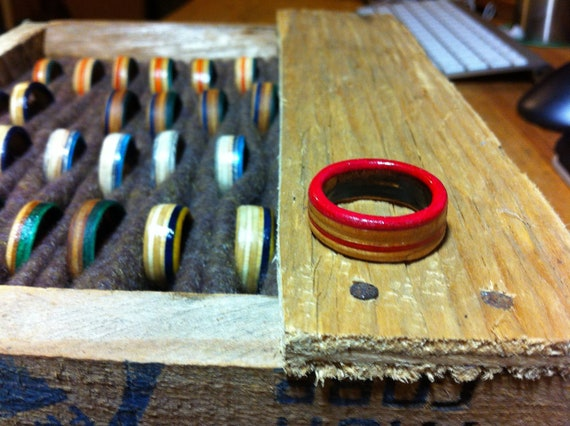 Rings with a pink stripe hand cut from skateboard decks
