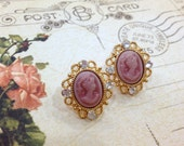 Rose Pink Cameo with intricate gold setting and shiny crystals