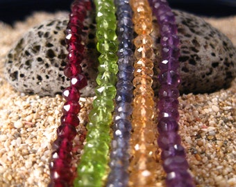 AAA Mixed Faceted Rondelles. 25 beads. Garnet, Peridot, Iolite, Topaz and Amethyst.
