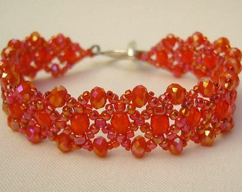 Filigree bracelet with sparkling beads in bright red