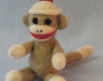 Miniature needle felted 'sock monkey'