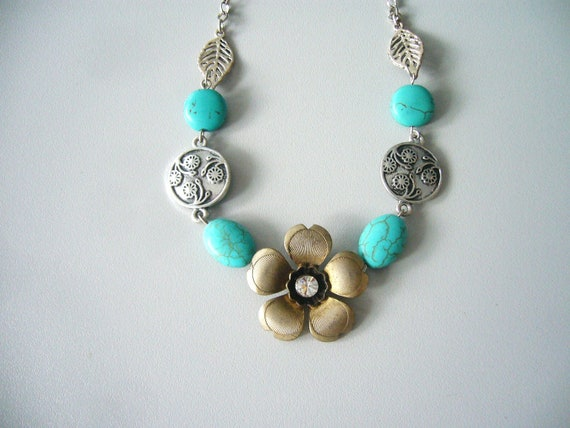 Turquoise flower necklace with gems, flowers and leaves